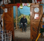 Bob sitting outside rustic yurt workshop 2004